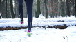 Jogger running in the forest at winter, steady, slow motion