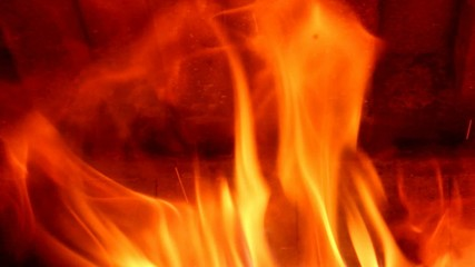 Flames of fire in fireplace
