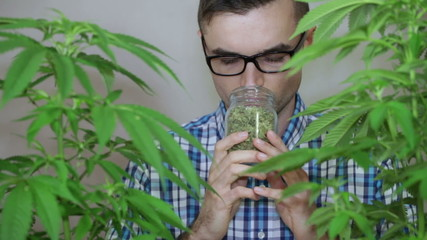 Man smelling Marijuana
