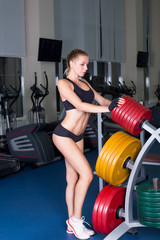 Sexy woman in fitness club