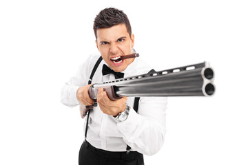 Aggressive man threatening with a shotgun
