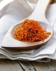 Saffron spice in a wooden spoon macro shot soft focus