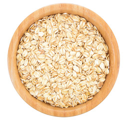 Rolled oats in wooden bowl isolated.