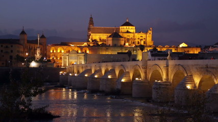 Mosque-cathedral of Cordoba and Roman bridge in evening