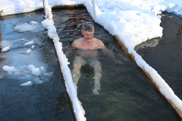 The man  in an ice-hole