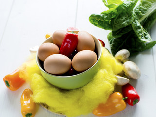Eggs into deep plate with  peppers and mushrooms