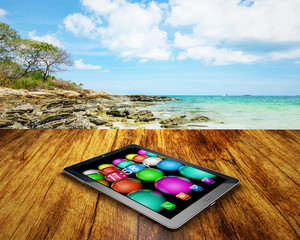 tablet PC  on wooden table outdoors