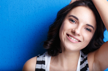 Portrait of a beautiful girl on a blue background.