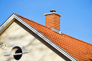 House roof with smoke stack