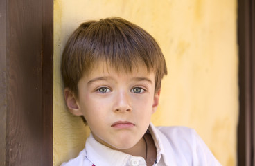 Portrait of a boy on a background of a wall