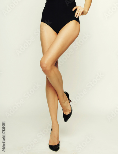 canvas print picture woman's legs in high-heeled black shoes