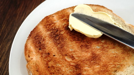 Buttering hot toast in slow motion with knife