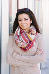 Portrait of young beautiful woman smiling with long scarf