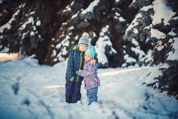 Two Kids in frosty winter Park. Outdoors.