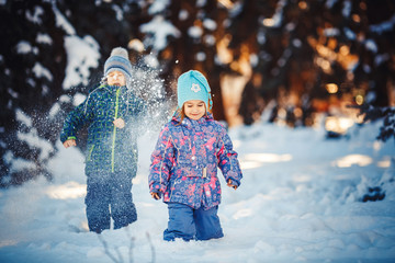 Two Kids in frosty winter Park. Outdoors.
