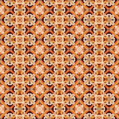 Orange kaleidoscope seamless abstract background.