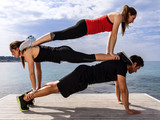 Fototapety One man and two women doing fitness tricks