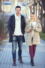 Young couple in a walk on the city street