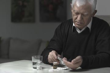 Man taking medicaments