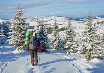 skier rises uphill
