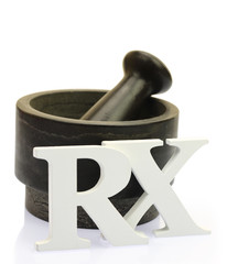 Empty mortar and pestle with white wooden RX letters isolated