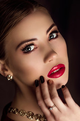 Closeup perfect portrait of woman with maroon lips