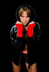 sexy boxing girl with wrapped hands wrists in hoodie jumper