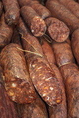Smoked sausages meat in domestic smokehouse.