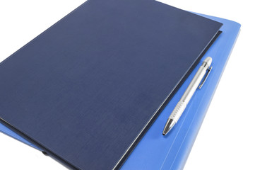 Two blue diary with pen