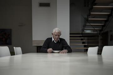 Elderly man eating dinner