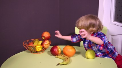 Kids twins playing with fruits
