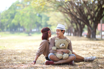 Attractive asian couple in love together in the park