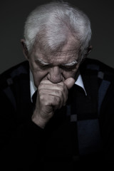 Old aged man mourns his wife
