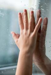 Hands through glass