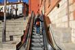 Leinwanddruck Bild - escalera mecanica en una calle de burgos
