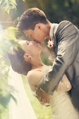 Bride and Groom Kissing Together in their Wedding Day