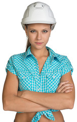 Pretty girl in shirt and white helmet standing with crossed arms