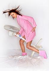 Beautiful woman in comfortable sleepwear  with blower