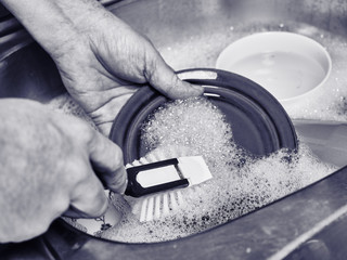 Man washing a dishes