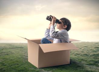 Young explorer using binoculars