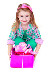 pretty little girl with a gift in their hands.