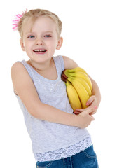 laughing little girl with a bunch of bananas mouse.