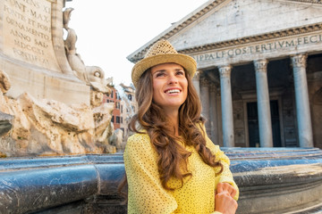 Portrait of young woman near fountain of the pantheon in rome