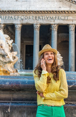 Woman talking cell phone near fountain of the pantheon in Rome