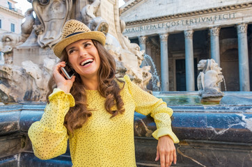 Portrait of woman talking cell phone near fountain  in Rome