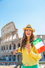 Portrait of happy young woman with italian flag  in Rome