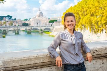 Young woman standing on bridge ponte umberto I
