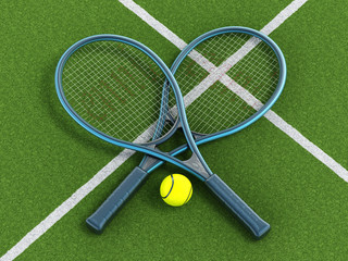Tennis rackets and ball on grass court