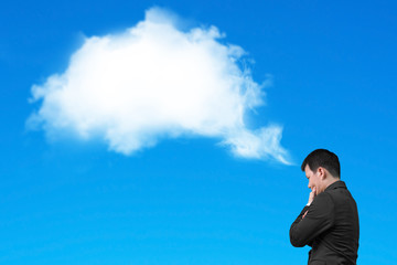 Businessman thinking about white cloud thought bubble isolated o