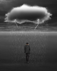 Depressed businessman walking with dark cloud of rain and lightn